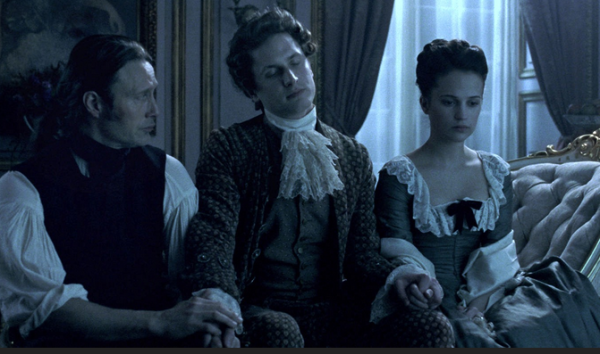 Dr. Struensee (Mads Mikkelsen), the Danish King Christian (Mikkel Boe Følsgaard), and Queen Caroline (Alicia Vikander)