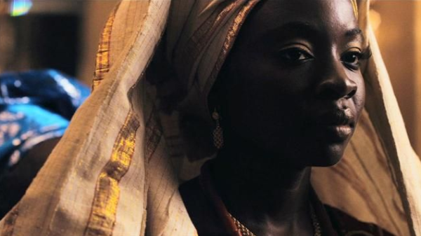 Adenike (Danai Gurira), Mother of George