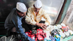 Dabbawallahs prepare lunchboxes for delivery