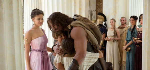 Megara (Irina Shayk) looks on as Hercules (Dwayne Johnson) returns home from battle