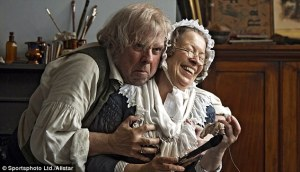 Mr. Turner and Mrs. Booth (Marion Bailey) enjoy a moment of levity.