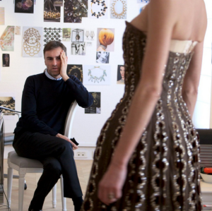 Raf Simons examines one of his creations