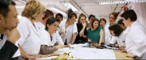 seamstresses study a design